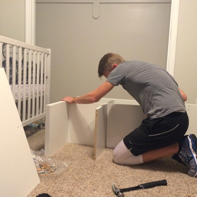 """The hubby hard at work on our nursery closet while I put my feet up and """"supervise."""" Doesn't get much better than that!"""