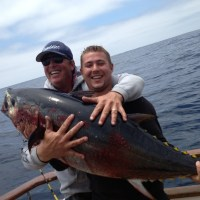 Mike ecstatic as deckhand Anthony hoists the big fish