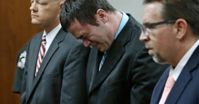 Daniel Holtzclaw, center, cries as he stands in front of the judge after the verdicts were read in his trial in Oklahoma City, Thursday, Dec. 10, 2015. Holtzclaw, a former Oklahoma City police officer, was facing dozens of charges alleging he sexually assaulted 13 women while on duty. Holtzclaw was found guilty on a number of counts. With Holtzclaw are defense attorneys Robert Gray, left, and Scott Adams, right. (AP Photo/Sue Ogrocki, Pool)
