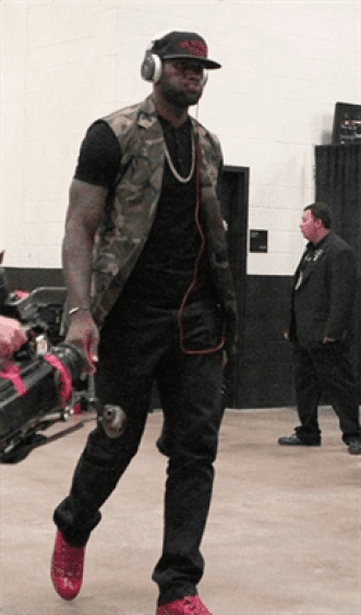 lebron-james-game-4-finals-hat-a-camouflage-sleeveless-jacket-black-jeans-and-Pavot-red-Balenciaga-sneaker