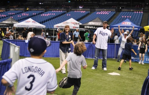 Tampa Bay Rays Josh Leuke High-Fives Base Runners During Rays Fan Fest, Tropicana Field, Feb. 18, 2012