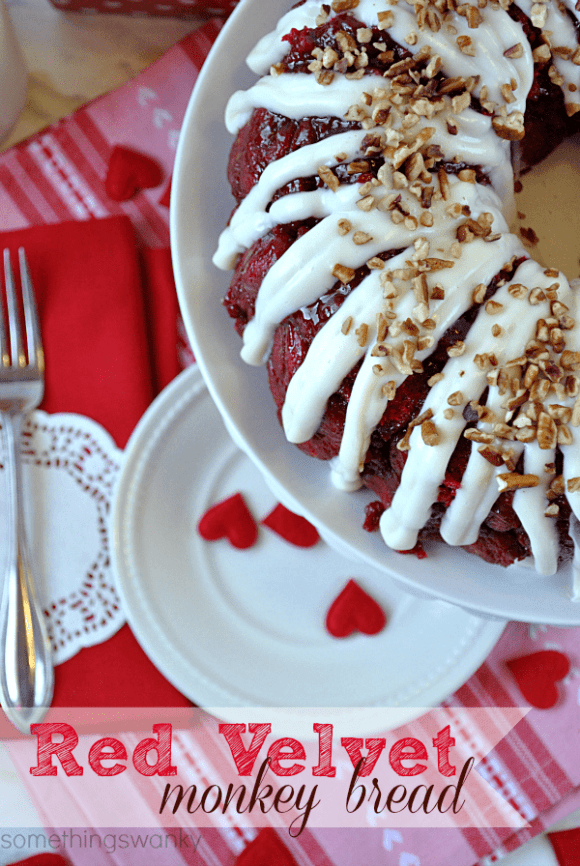 Red Velvet Monkey Bread | We gobbled. this. up. It is absolutely AMAZING. It's soft, and warm, and perfectly gooey. Possibly the best monkey bread I've ever eaten! And SUPER easy! #monkeybread #bread #recipe #redvelvet #valentines