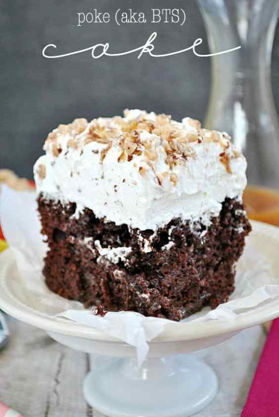 BTS Cake aka Poke Cake aka The BEST Cake you'll ever eat!! This super moist and decadent cake is smothered in whipped cream, Heath Toffee, and caramel sundae sauce | www.somethingswanky.com