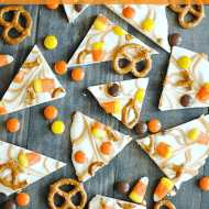 White chocolate and swirls of peanut butter paired with Candy Corn, Reese's Pieces, and Pretzels make for festive sweet & salty treat!
