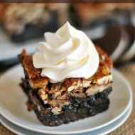 Ooey, gooey pecan pie bars with a decadent Oreo crust! A genius twist on a classic pie!