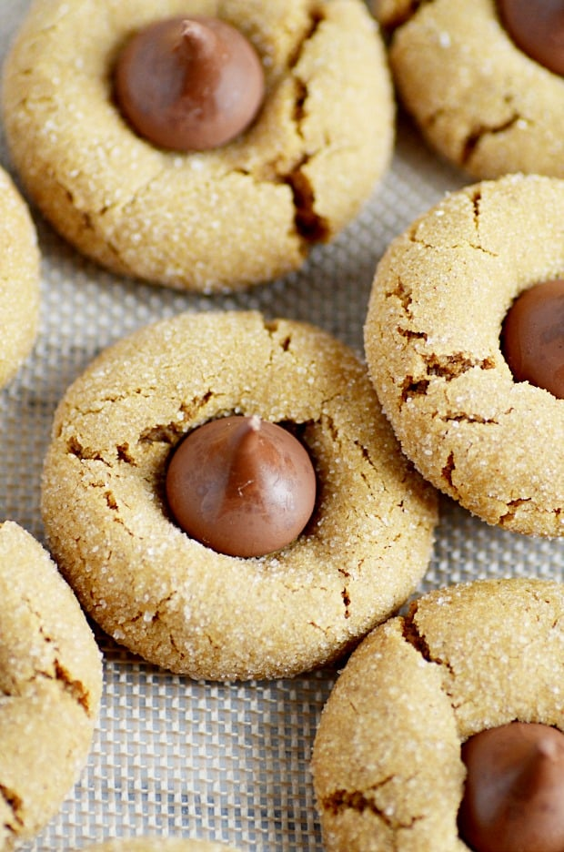 Soft and chewy gingerbread cookies stuffed with a Hershey Kiss. So ...