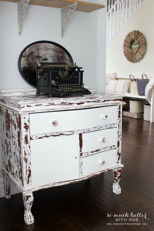 Chippy cowhide dresser and old typewriter by somuchbetterwithage.com