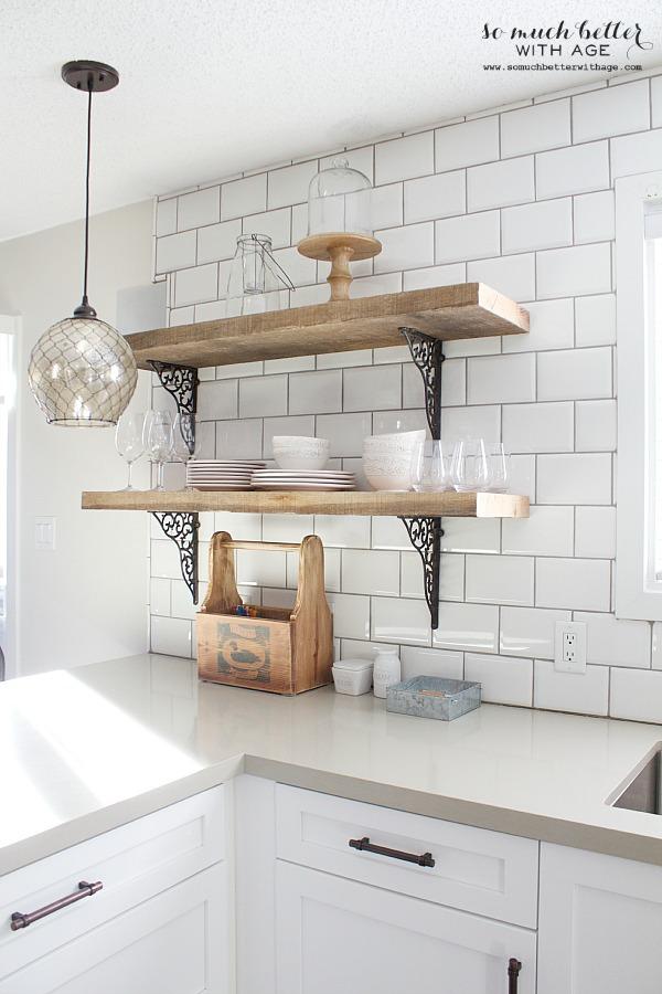 Rustic barn wood kitchen shelves | somuchbetterwithage.com