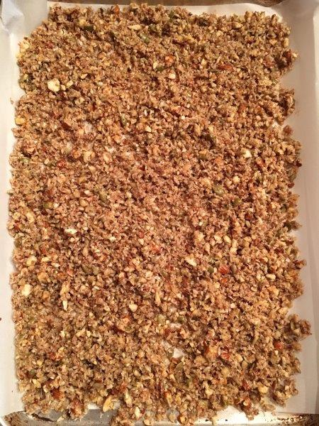 Gluten free natural granola spread on pan bake in oven
