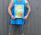 Woohoo!!: Establece récord Guinness por tatuajes de Homero Simpson