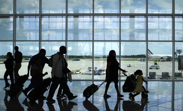 Passengers walk through the newly opened Maynard H. Jackson Jr. International Terminal in Atlanta, Georgia