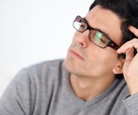 Man holding model brain, thinking