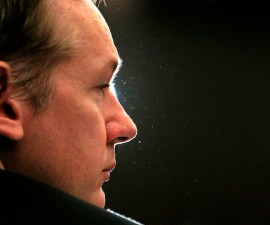 File photo of Wikileaks founder Julian Assange listening during a news conference in London