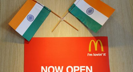 Indian flags adorn a McDonald's sign in New Delhi