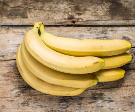 Bunch of Bananas on Grunge Wooden Background. Top View