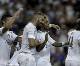 MADRID, SPAIN - AUGUST 29: Karim Benzema (2ndL) celebrates scoring their third goal with teammates James Rodriguez (L), Marcelo (2ndR) and Gareth Bale (L) during the La Liga match between Real Madrid CF and Real Betis Balompie at Estadio Santiago Bernabeu on August 29, 2015 in Madrid, Spain.  (Photo by Gonzalo Arroyo Moreno/Getty Images)