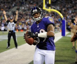 Baltimore Ravens wide receiver Steve Smith prepares to throw the ball into the stands after scoring a touchdown in the first half of an NFL preseason football game against the Washington Redskins, Saturday, Aug. 23, 2014, in Baltimore. (AP Photo/Nick Wass)