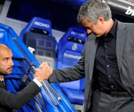 "Real Madrid's coach Jose Mourinho (R) and Barcelona's coach Pep Guardiola shake hands before the start of their Spanish first division soccer match at Santiago Bernabeu stadium in Madrid in this April 16, 2011 file photo.  One intriguing sideshow to Barcelona's Champions League semi-final against Real Madrid is the duel between two coaches who have a shared history and similar working methods but starkly contrasting personalities. When the La Liga giants clash in their first leg at Real's Bernabeu stadium on April 26, the third of four Spanish ""Clasicos"" in 18 days, Barca's pensive, enigmatic manager, the Catalan Guardiola, will again lock horns with outspoken Portuguese Mourinho.  REUTERS/Felix Ordonez/Files (SPAIN - Tags: SPORT SOCCER)"