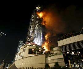 A fire engulfs The Address Hotel in downtown Dubai in the United Arab Emirates December 31, 2015. REUTERS/Ahmed Jadallah      TPX IMAGES OF THE DAY
