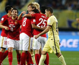 Paulinho of China's Guangzhou Evergrande celebrates with teammates after winning their Club World Cup quarter-final soccer match against Mexico's Club America during in Osaka