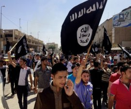 """FILE - In this June 16, 2014 file photo, demonstrators chant pro-Islamic State group slogans as they carry the group's flags in front of the provincial government headquarters in Mosul, 225 miles (360 kilometers) northwest of Baghdad. Branding experts say an unfortunate association with a name, like businesses and brands who share the name """"Isis"""" with the notorious Islamic militant group, can scar a company's reputation with customers even if the connection is just coincidental. (AP Photo, File)"""