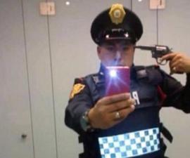 policia suicidio pistola selfie