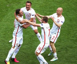 SAINT-ETIENNE, FRANCE - JUNE 25:  (L to R) Grzegorz Krychowiak, Slawomir Peszko, Jakub Blaszczykowski and Michal Pazdan of Poland celebrate their win through the penalty shootout after the UEFA EURO 2016 round of 16 match between Switzerland and Poland at Stade Geoffroy-Guichard on June 25, 2016 in Saint-Etienne, France.  (Photo by Alex Livesey/Getty Images)