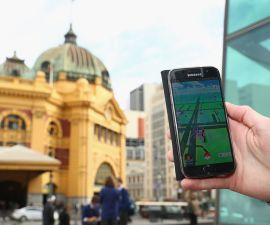 A man holds up his phone as he plays the pokemon Go game on July 13, 2016 in Melbourne, Australia. The augmented reality app requires players to look for Pokemon in their immediate surroundings with the use of GPS and internet services turning the whole world into a Pokemon region map. The hugely popular app has seen Nintendo shares soar following its limited release in the US, Australia and New Zealand on July 6.
