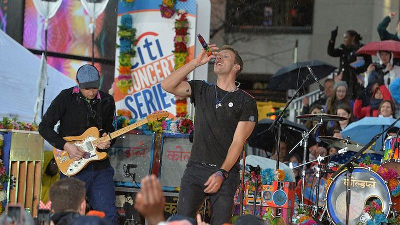 "NEW YORK, NY - MARCH 14:  Guitarist Jonny Buckland (L) and singer Chris Martin of Coldplay perform on NBC's ""Today"" at Rockefeller Plaza on March 14, 2016 in New York City.  (Photo by Slaven Vlasic/Getty Images)"