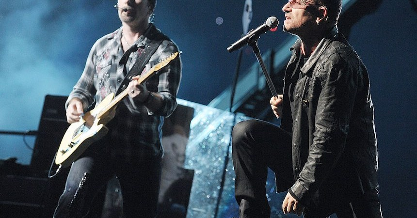 "PASADENA, CA - OCTOBER 25:  Musician The Edge (L) and singer Bono of U2 perform onstage during their ""360 Degrees Tour"" at the Rose Bowl on October 25, 2009 in Pasadena, California.  (Photo by Kevin Winter/Getty Images) *** Local Caption *** Bono;The Edge"
