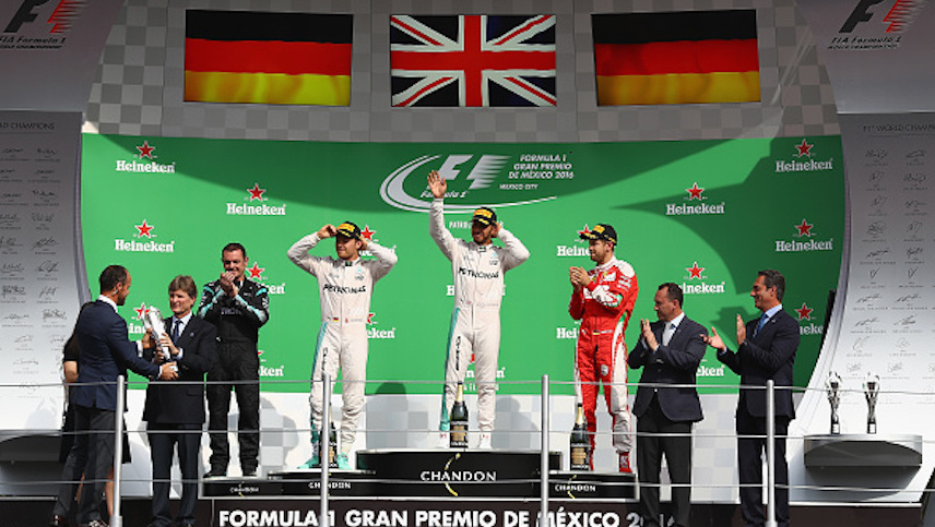 MEXICO CITY, MEXICO - OCTOBER 30: Top three finishers Lewis Hamilton of Great Britain and Mercedes GP, Nico Rosberg of Germany and Mercedes GP and Sebastian Vettel of Germany and Ferrari celebrate on the podium during the Formula One Grand Prix of Mexico at Autodromo Hermanos Rodriguez on October 30, 2016 in Mexico City, Mexico. (Photo by Clive Mason/Getty Images)