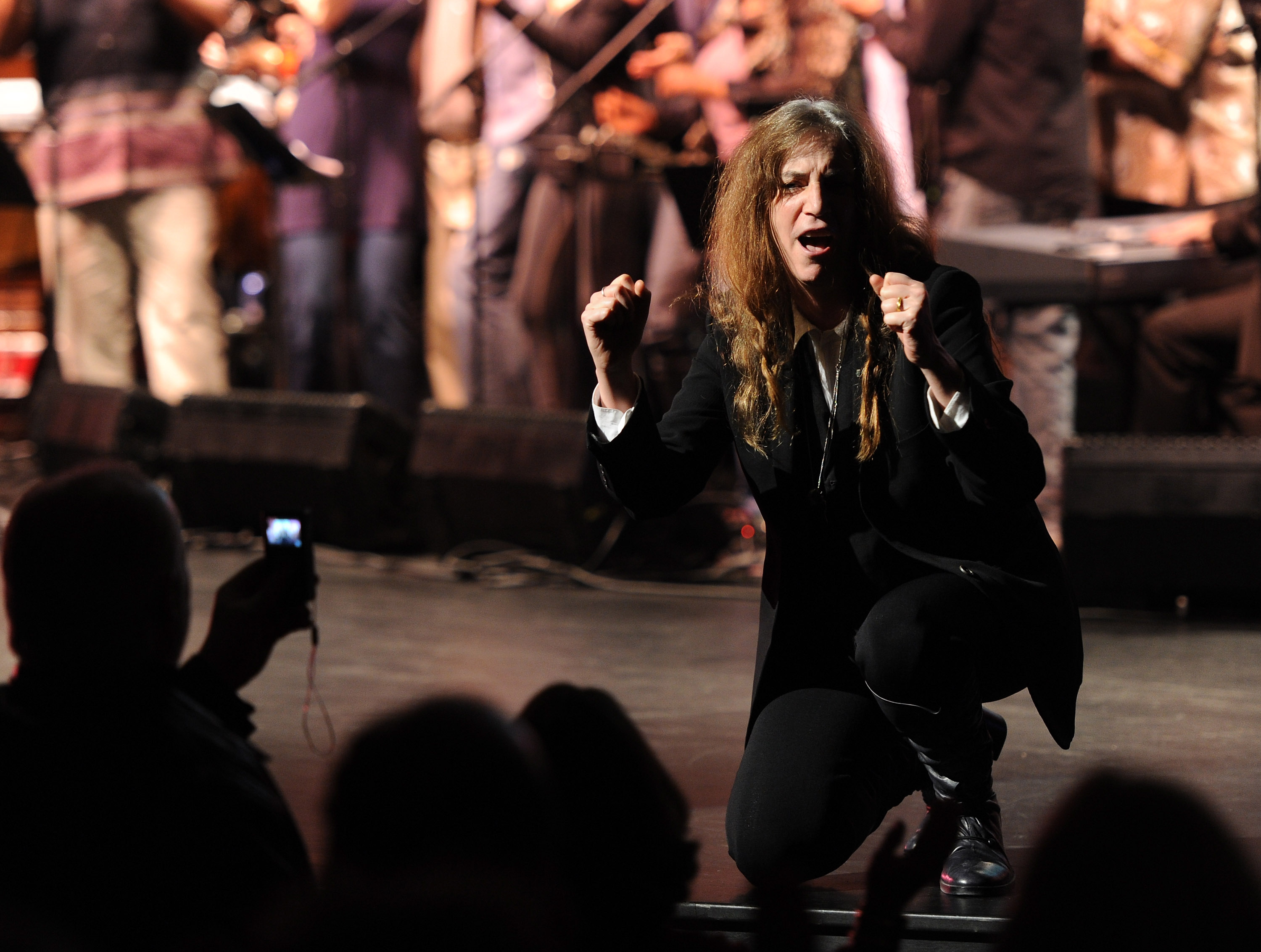 NEW YORK - NOVEMBER 12: Singer Patti Smith performs during Theatre Within's 30th Annual John Lennon Tribute Concert Benefitting the Playing For Change Foundation at the Beacon Theatre on November 12, 2010 in New York, City. (Photo by Stephen Lovekin/Getty Images)