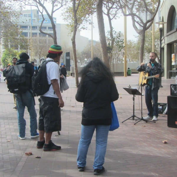 CAL SINGS AT 7TH ST AND MARKET.