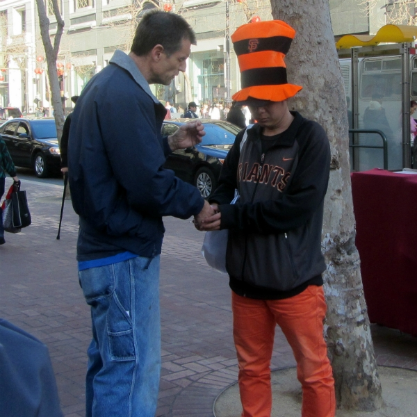 MIKE PRAYS WITH MAN AT 5TH AND MARKET.