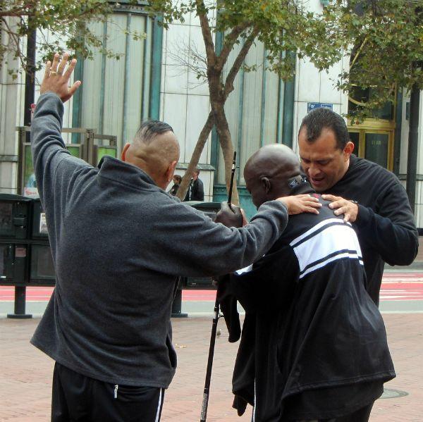 PRAYING FOR MAN AT UN PLAZA