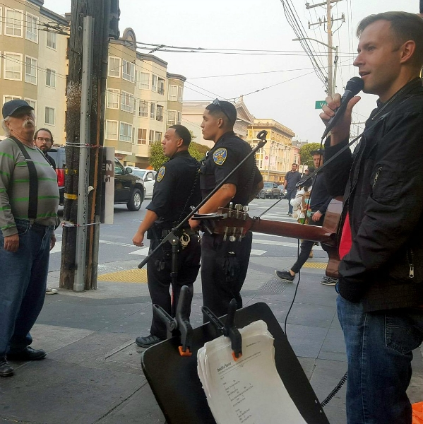 POLICE CONFRONT HECKLER AS CAL PREACHES AT 16TH AND VALENCIA