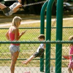 Why bringing your smart phone to the swings to watch your kids play is good parenting