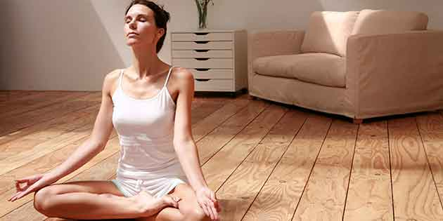 woman-meditating-in-living-room-630-x-315-low
