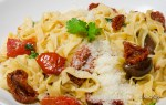Tagliatelle Calabrese. Fresh tagliatelle pasta with sole de puglia, tomatoes, balsamic onions garlic sun-dried tomatoes pine nuts, basil and Grana Padano cheese.