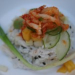 Coconut crab topped with thinly sliced cucumber, avocado, mango and kimchi