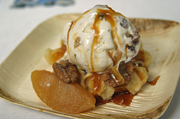 Belgian Liege waffle was topped with rum raisin ice cream and farmers market apples, caramel sauce and caramelized pecans