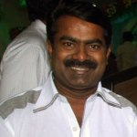 Seeman penning a book in prison