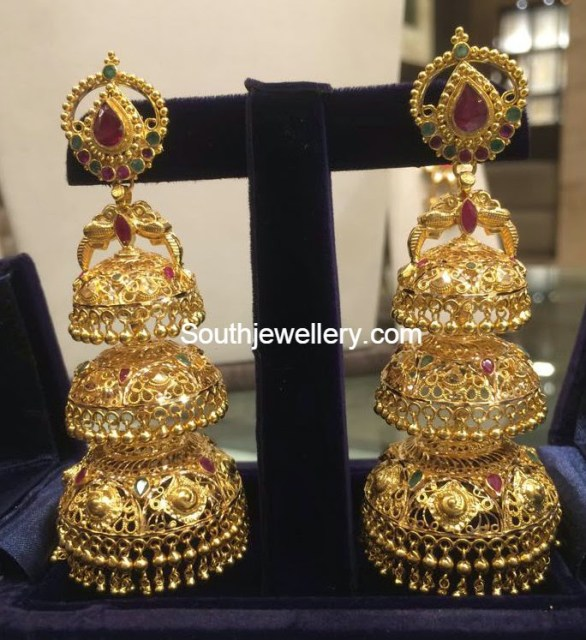 22 carat gold three step gold jhumkas festooned with rubies and