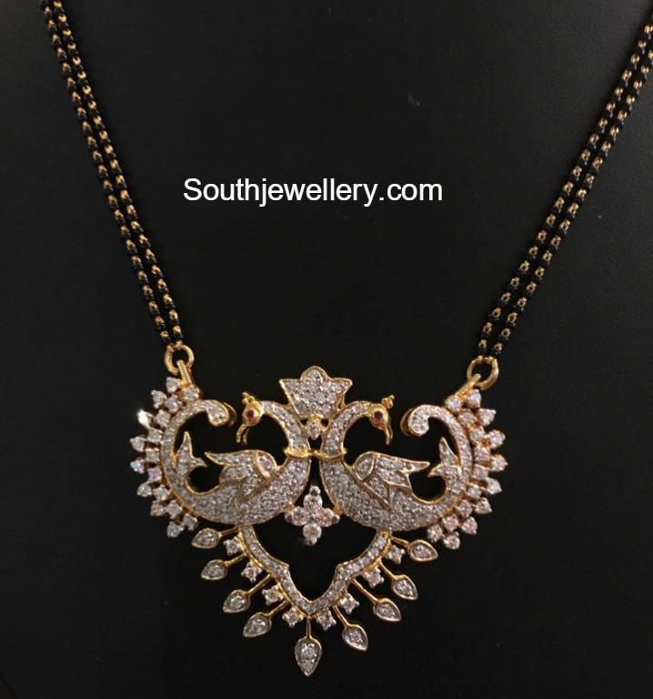 Black beads mangalsutra with peacock pendant jewellery
