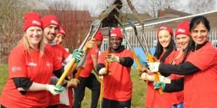 Virgin Media volunteers help dig allotment