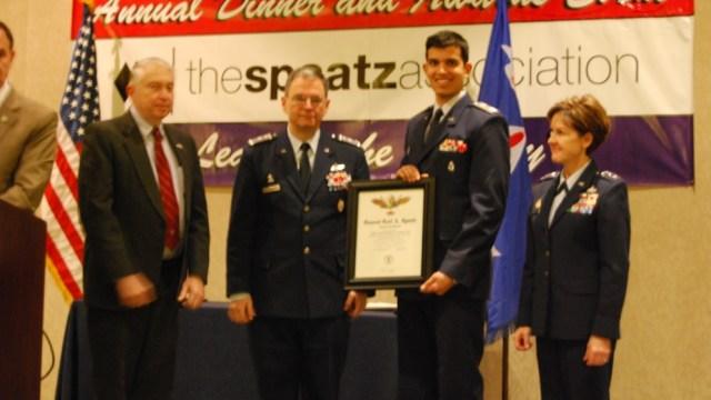 Above: Kenneth Kelly, Brig Gen Joseph Vazquez, and Lt Gen Fedder, present Capt Eashan Samak the Spaatz Award certificate.