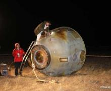 The Shenzhou-8 reentry capsule following its successful landing in Mongolia (Credits: Xinhua/Li Gang).
