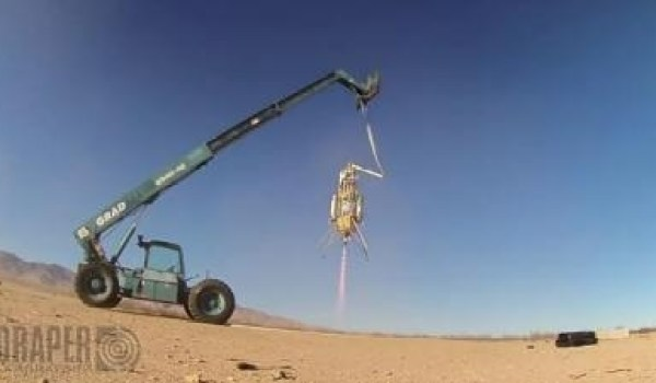 Masten rocket during the tethered test flight with the GENIE system (Credits: Draper Laboratory)