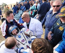 Burbank being carried to the medical tent after being extracted from the Soyuz (Credits: Kirill Kudryavtsev / AFP - Getty Images).