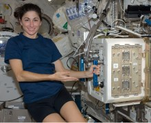 Astronaut Nicole Stott displays the Mice Drawer System on ISS during Expedition 21 (Credits: NASA).
